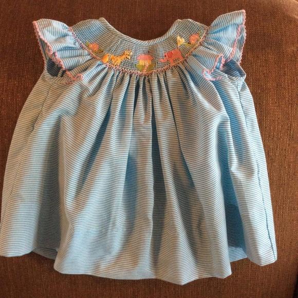9d978381e3fd Petit Bebe Boutique Noah's Ark Smocked Dress. M_5be1e31e04e33dc6de1e880a